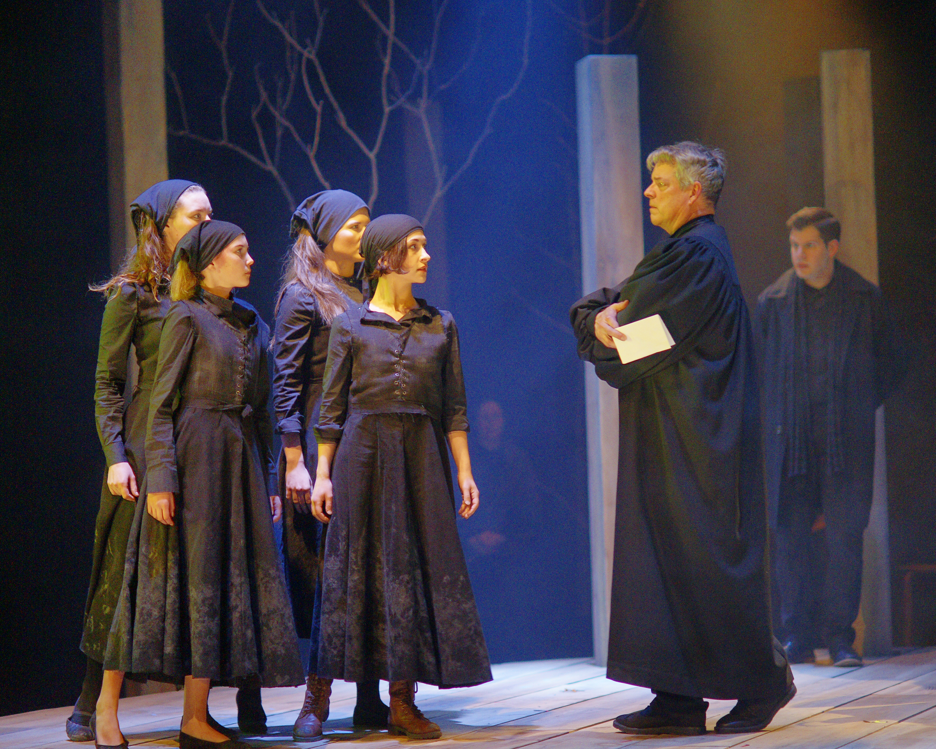 Front: Abigail Craven as Betty Parris, Courtney Lamanna as Abigail Williams, David John Phillips as Danforth | Back: Joanna Decc as Mercy Lewis, Charlin McIsaac as Suzanna Walcott, Anthony Botelho as Reverend Parris